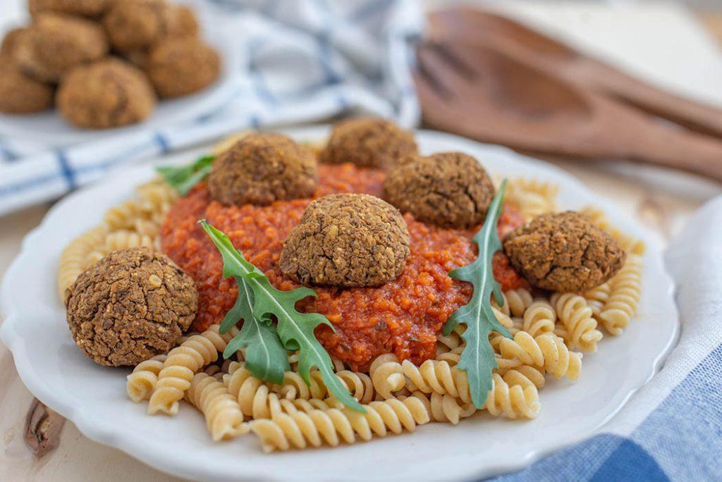 bowl of whole grain spaghetti with tofu neat balls.
