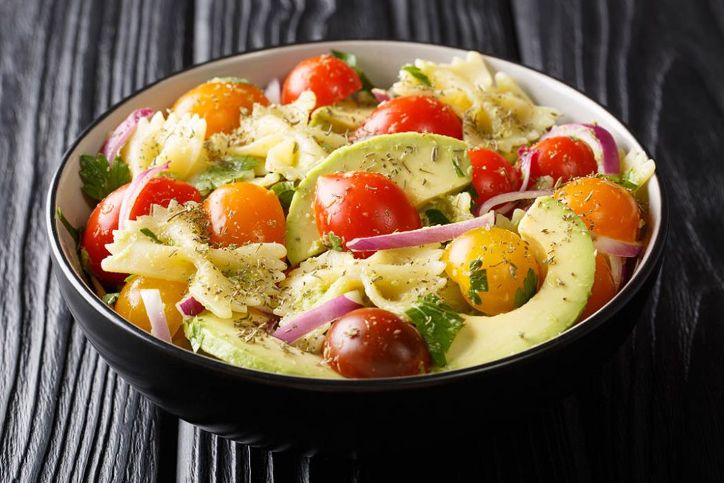 homemade pasta sald with onion, red onions, tomatoes, avocados