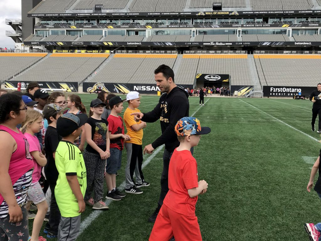 Kids on the playing field at Tim Hortons Field