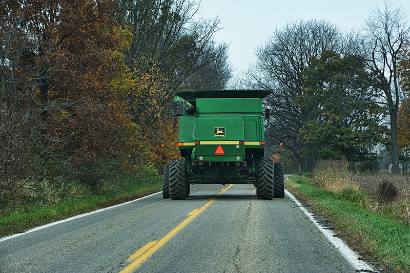 road safety. combine on road during harvest