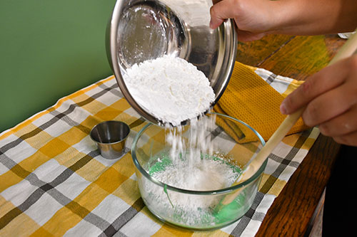 Adding Corn Starch to the glue and dishsoap to make corn slime