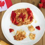 homemade whole wheat pancakes make into maple leaf shapes and the Canadian flag to celebrate Canada Day