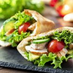 whole wheat pita stuffed with chicken and fresh vegetables.