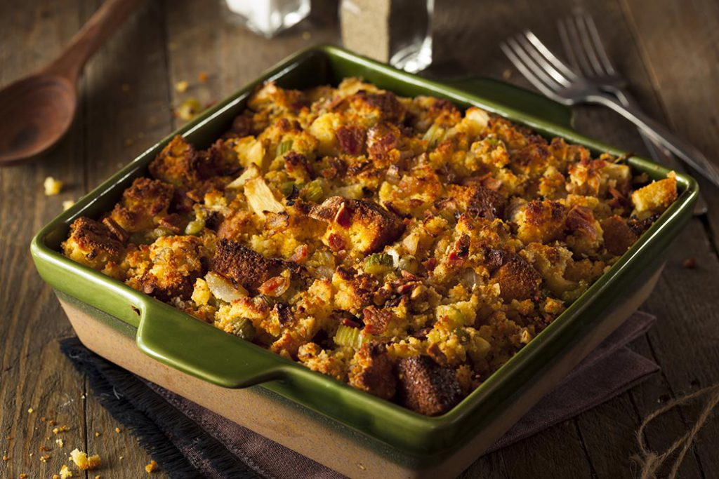 Holiday cornbread stuffing with celery and onion on a wood table