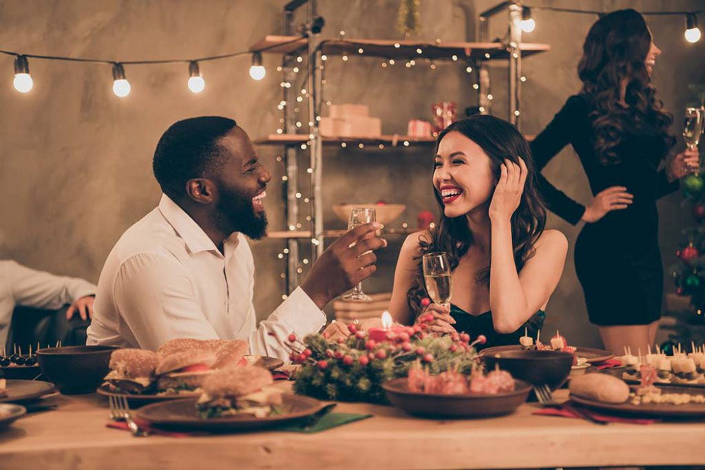 small holiday gathering with man and woman talking