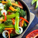 Healthy stir fried vegetables in the pan and ingredients close up